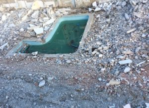 Pool in the middle of demolition.