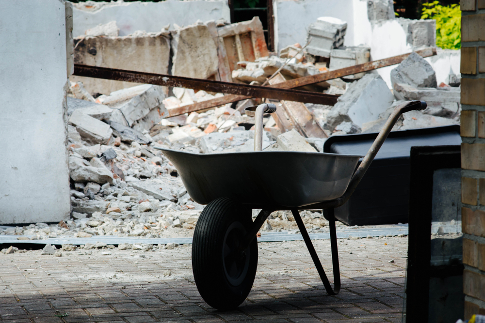 Demolition Site with Construction Materials and Wheelbarrow