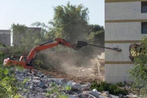 Demolition team working to demolish a structure.